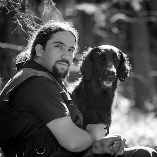 picture of Ramin Miraftabi with a flatcoated retriever