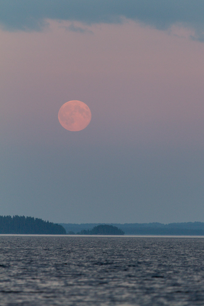 Super moon of 2013 rising above a lake