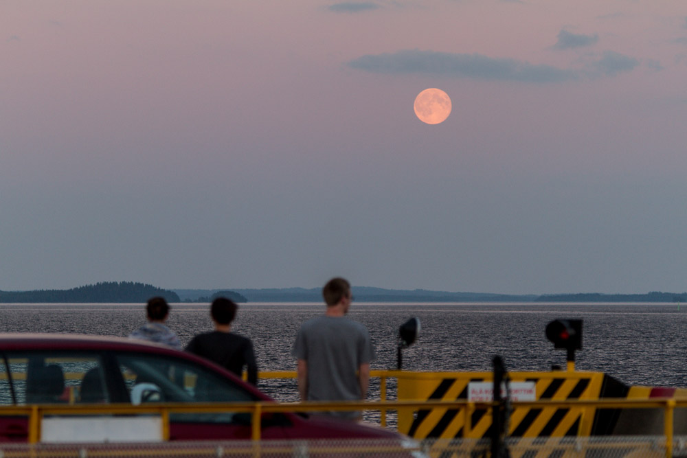super moon of 2013 with people watching it from a ferry